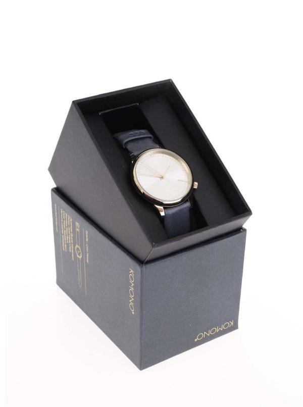 Dámske hodinky v zlatej farbe s modrým koženým remienkom Komono Estelle