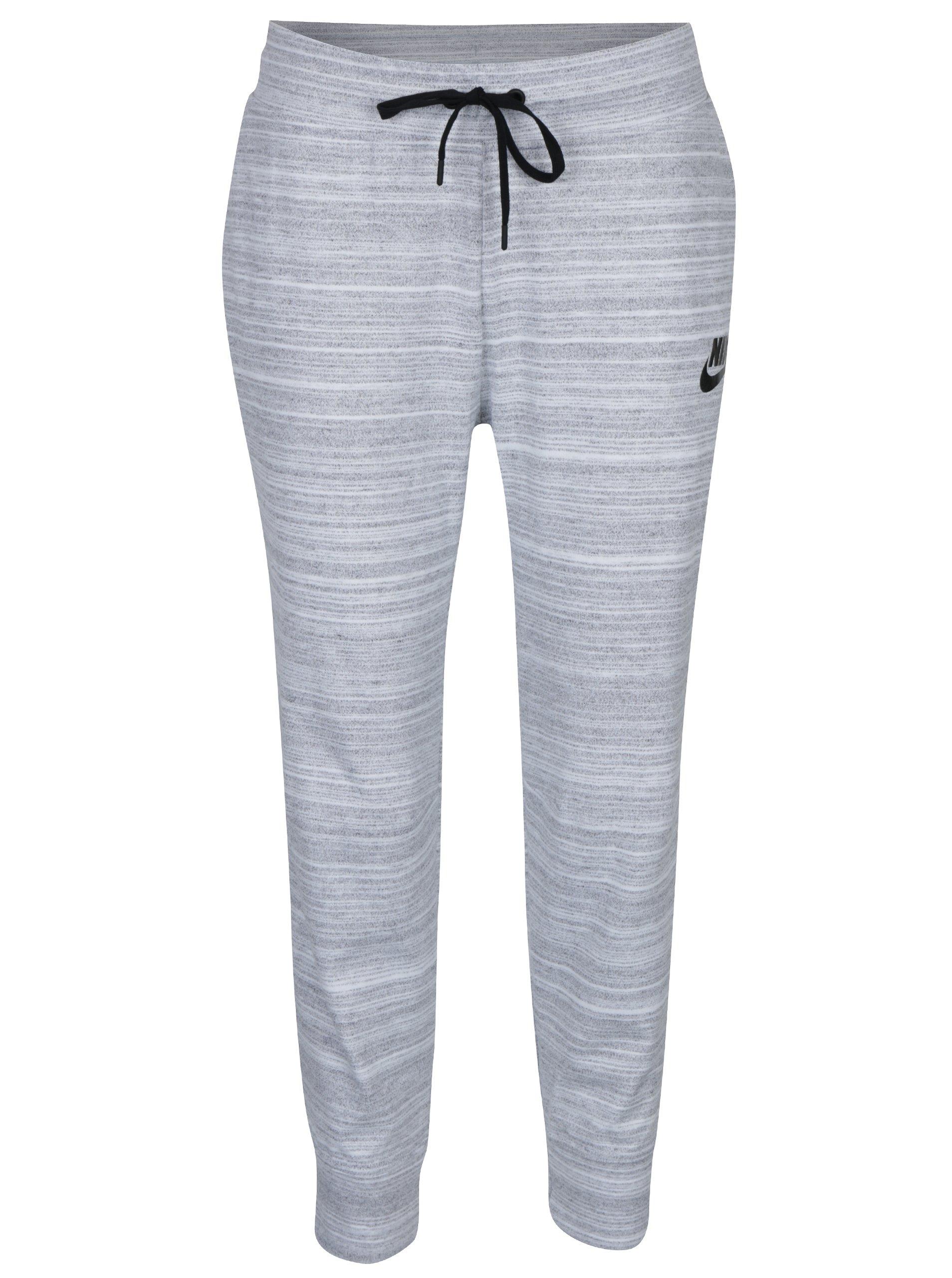 b156e3315d883 Svetlosivé dámske melírované tepláky Nike Sportswear Advance 15 ...