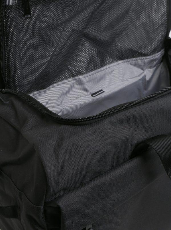 Čierna cestovná taška s ramennými popruhmi Herschel Outfitter 63 l