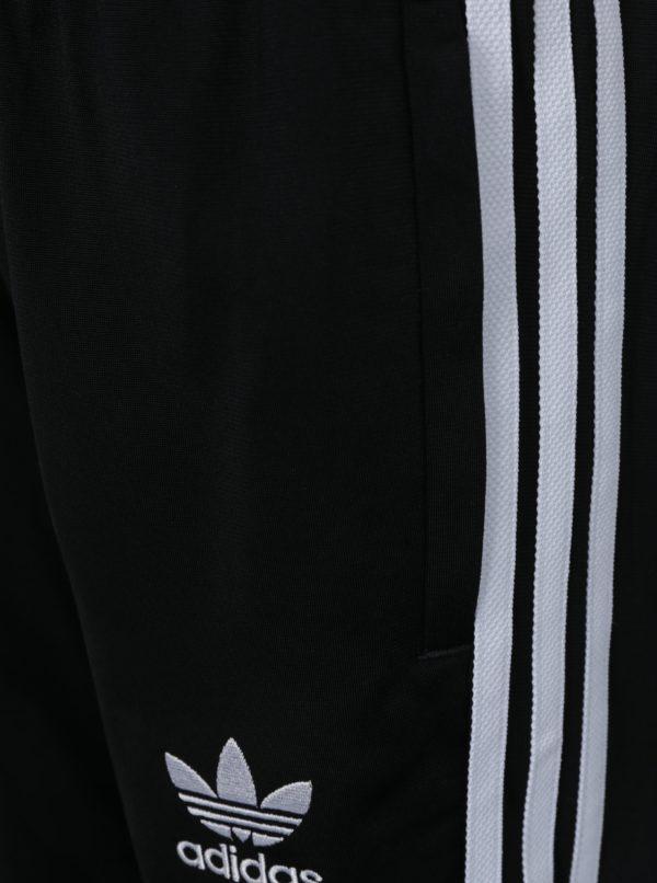 Čierne chlapčenské tepláky s bielymi pruhmi adidas Originals