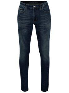 Tmavomodré pánske skinny rifle s vyšúchaným efektom Calvin Klein Jeans