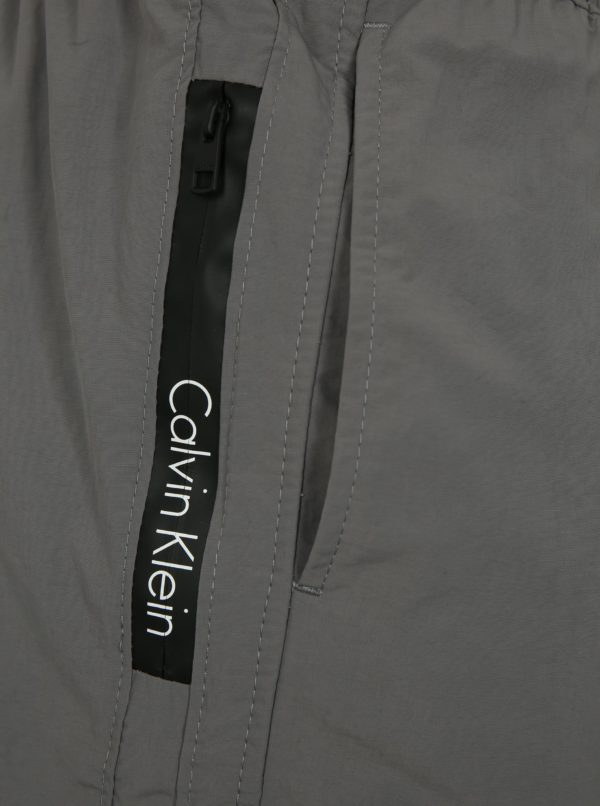 Sivé pánske plavky s gumou v páse Calvin Klein Underwear